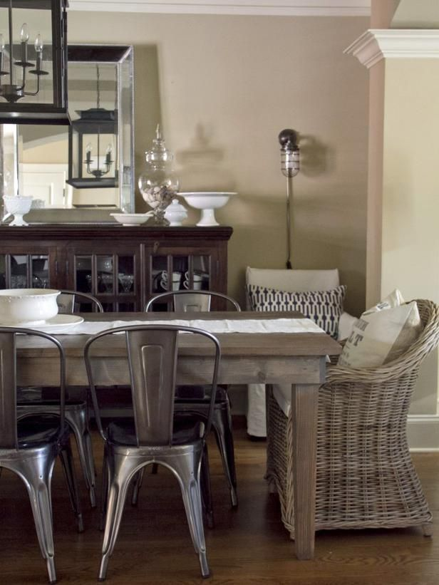 A Mix Of Rustic Metal Chairs With Wicker Dining Chairs