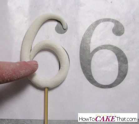 Oneedible decoration every cake decorator needs to know how to make is a gum paste or fondant stand up number topper! Number