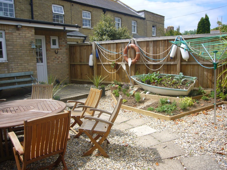 seaside garden using reclaimed and painted boat as a herb ... on Nautical Backyard Ideas id=20734