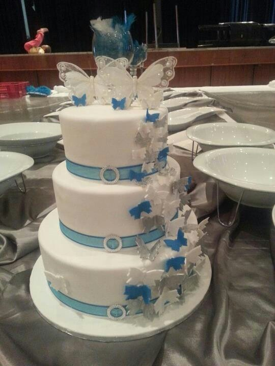 3 Tier Wedding Cake Buttericing With Baby Blue Ribbon And