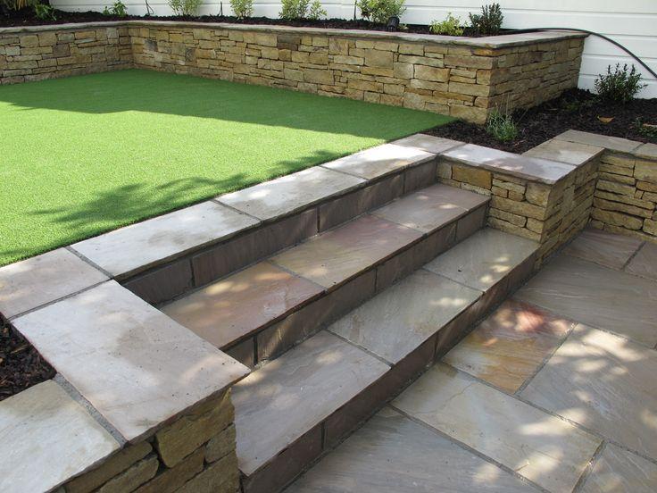Split level low maintenance garden scheme with natural ... on Split Garden Ideas id=34990