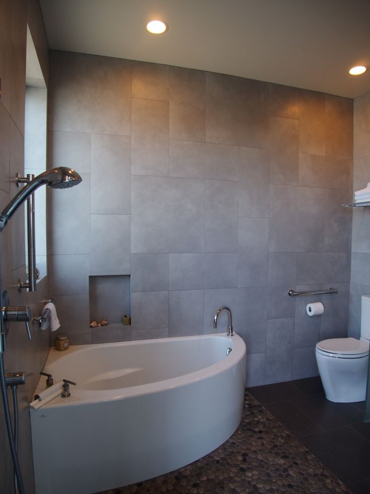 A small corner soaking tub shares a compact wet room with ... on Wet Room With Freestanding Tub  id=35297