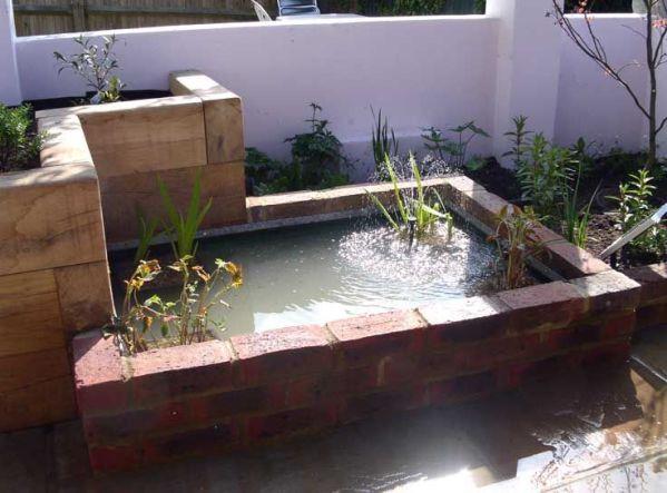 raised koi pond garden semi raised pond in flower bed, Hove garden pond raised