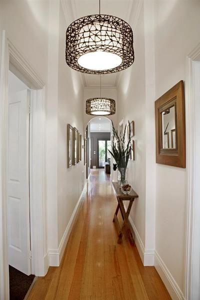 Narrow Hall Table Matching Frames And Repeating Light