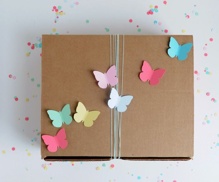 Looking for a simple way to dress up your gift packaging? Take a cue from A Pretty Cool Life, who used #marthastewartcrafts butterfly punches to decorate this kraft box! #12monthsofmartha: