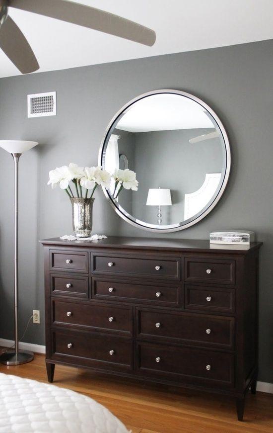 Gray walls, dark brown furniture—bedroom? Paint color: Amherst Grey – Benjamin Moore.