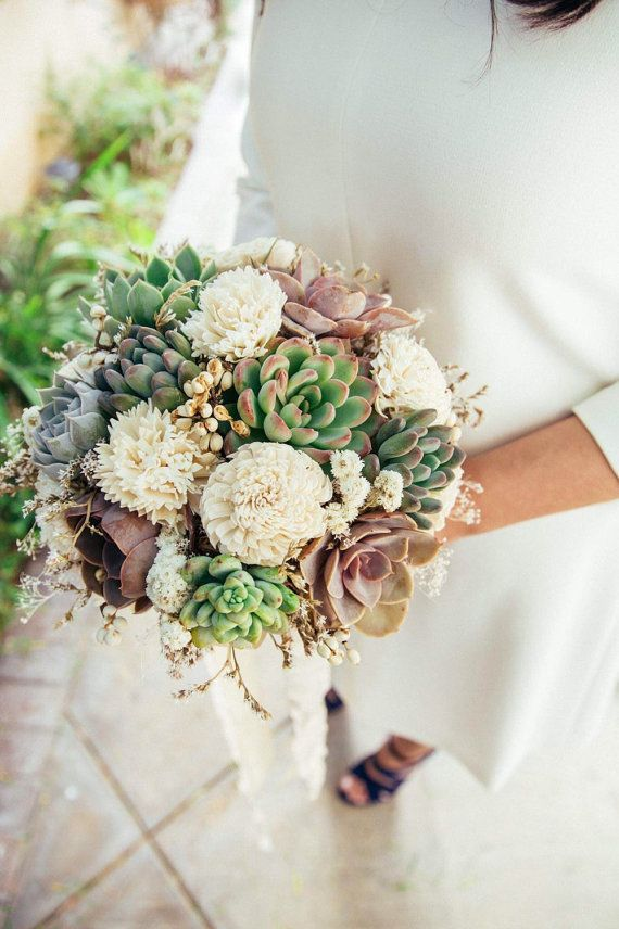 A Beautiful Bridal Bouquet Of Assorted Succulents Sola