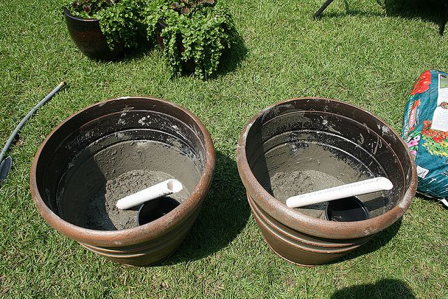 cement pvc into pots as base for sun shade