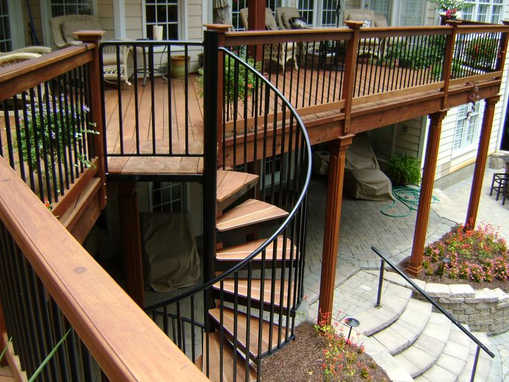 Second Story Wood Deck With Spiral Staircase And Stone