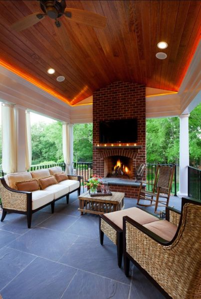 outdoor living space ideas for patios Porch Design Ideas. Inviting porch with fireplace