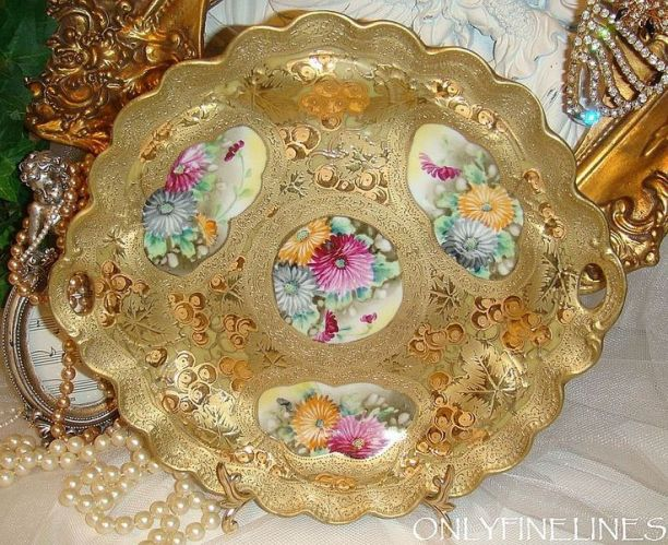 This fabulous, Nippon plate is lavished in a radiant gold, art nouveau, design highlighted with bright shiny, gold accents and finished off with: