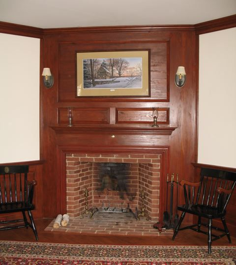Cape CodColonial Fireplace Raised Wood Paneling Sconces