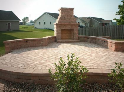 paver patio designs with fireplace outdoor fireplace | Elevated paver patio with outdoor