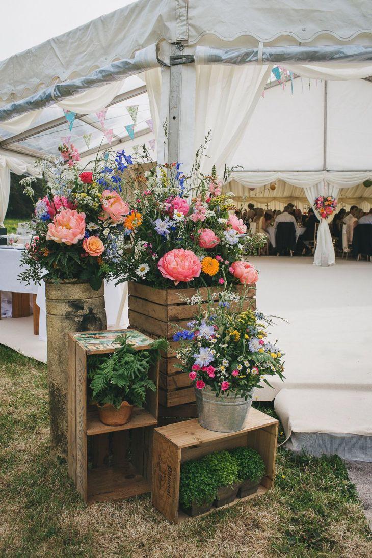 Colourful Hanging Paper Lantern u Wild Flower Filled Marquee Wedding