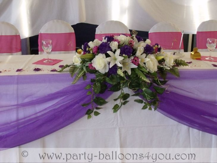 long vases for reception tables  Looking at ways to decorate your