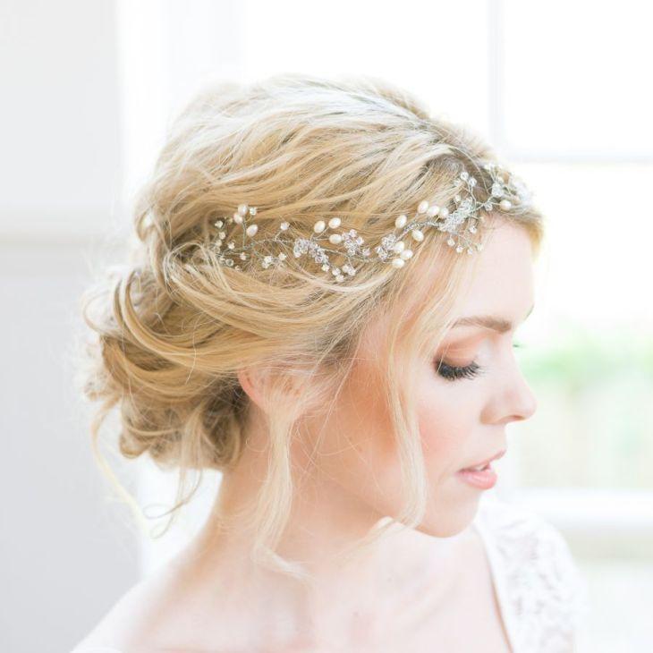 The beautiful handmade Fern bridal hair vine is an exquisite