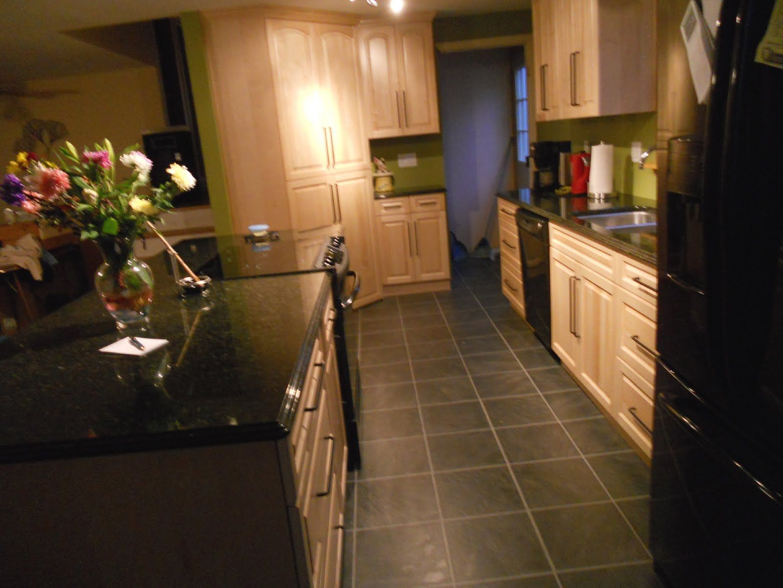 light colored oak cabinets with granite countertop ... on Black Granite Countertops With Maple Cabinets  id=38043