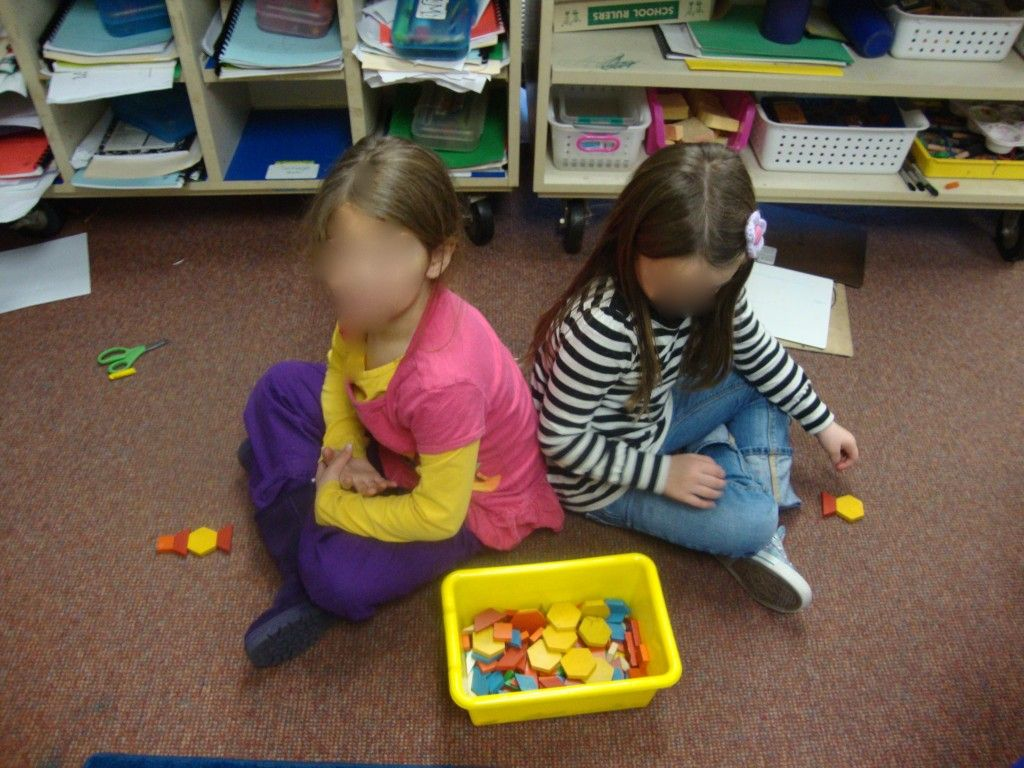 Students Sit Back To Back With The Box Of Pattern Blocks