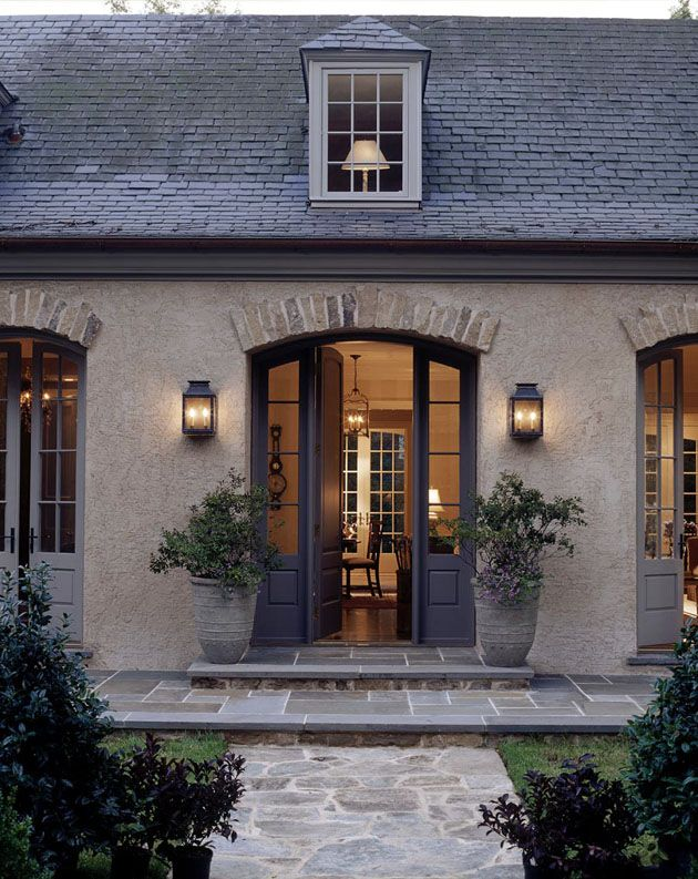 I love this look…French country…old stone, brick trim above doors, color scheme…would love to make our house have a kind of