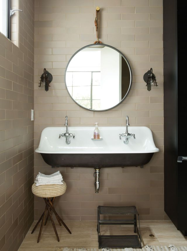 A kid friendly double sink from Kohler in the playroom half bath