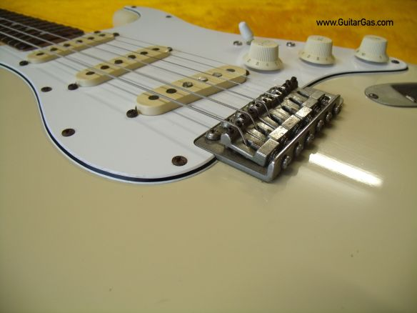 A close look at the solid steel bridge sadles on a Fernandes Stone logo Strat copy from the early 80s.