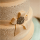 Vintage inspired wedding cake lace detail and ribbon with antique