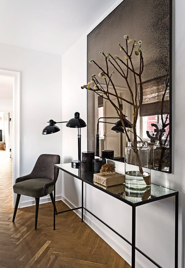 Modern Entryway With A Long Console Table Upholstered