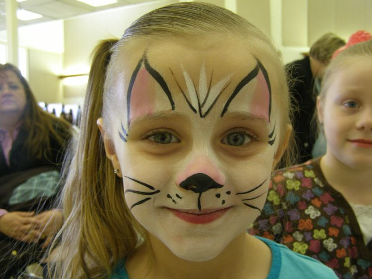 Face painting cat or kitten put a light wash of white