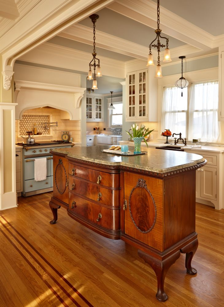 The centerpiece of the kitchen is an antique French cabinet expanded