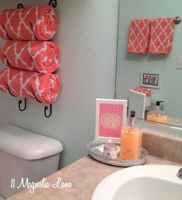 our new home~girl's bathroom in aqua and coral | wine rack, coral