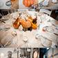 Fall decor for wedding The wedding reception tables featured pumpkins and gourds for this