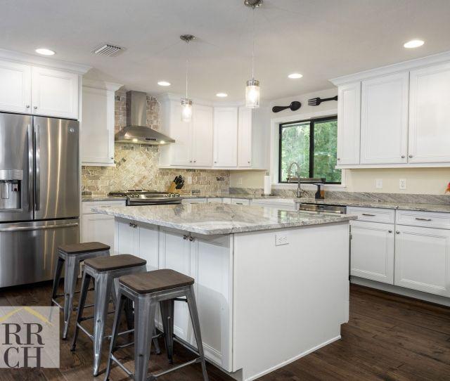 White Raised Panel Cabinets Granite Counter Tops Farmhouse Sink Brick Backsplash