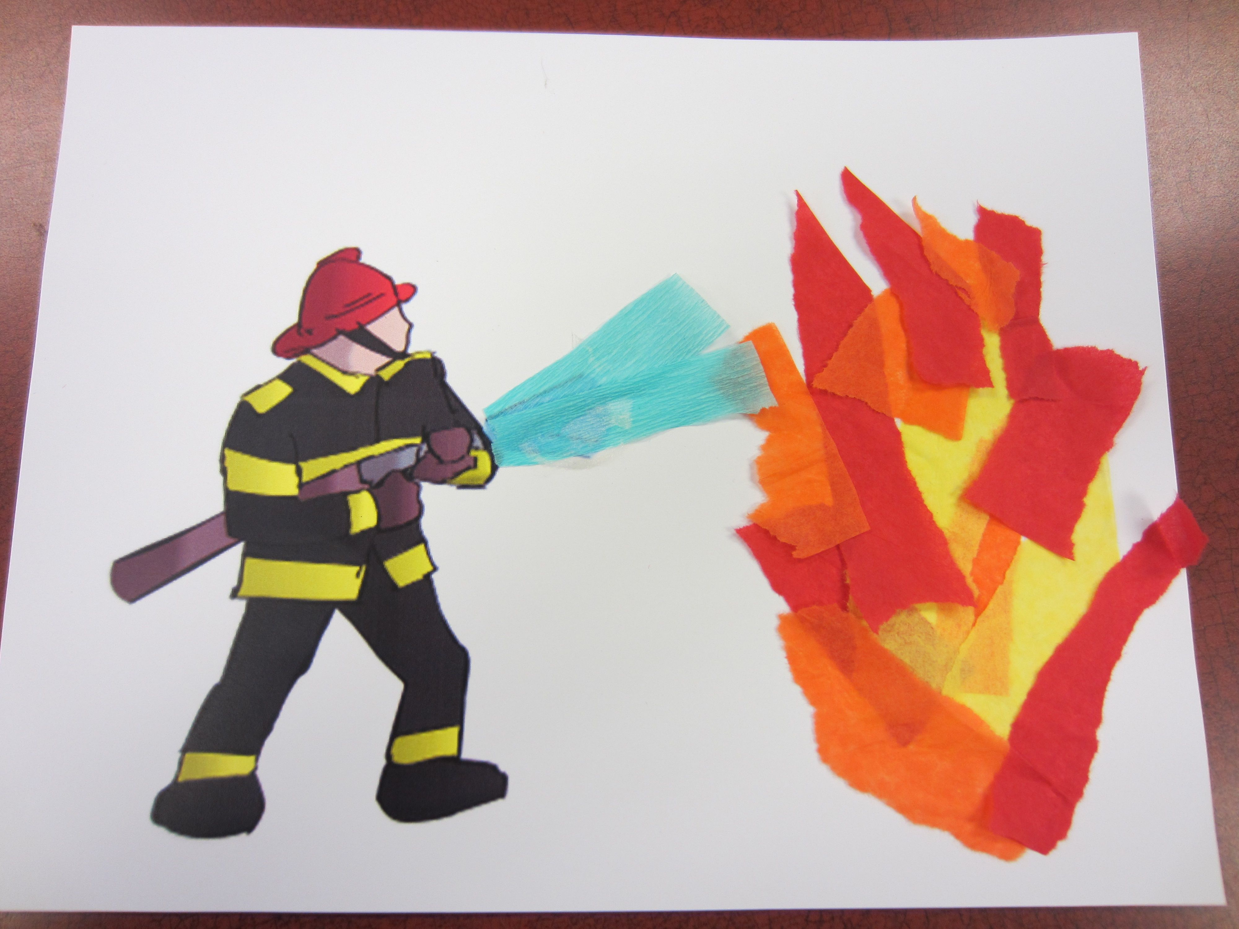A Pre Printed Firefighter Picture And Torn Tissue Paper