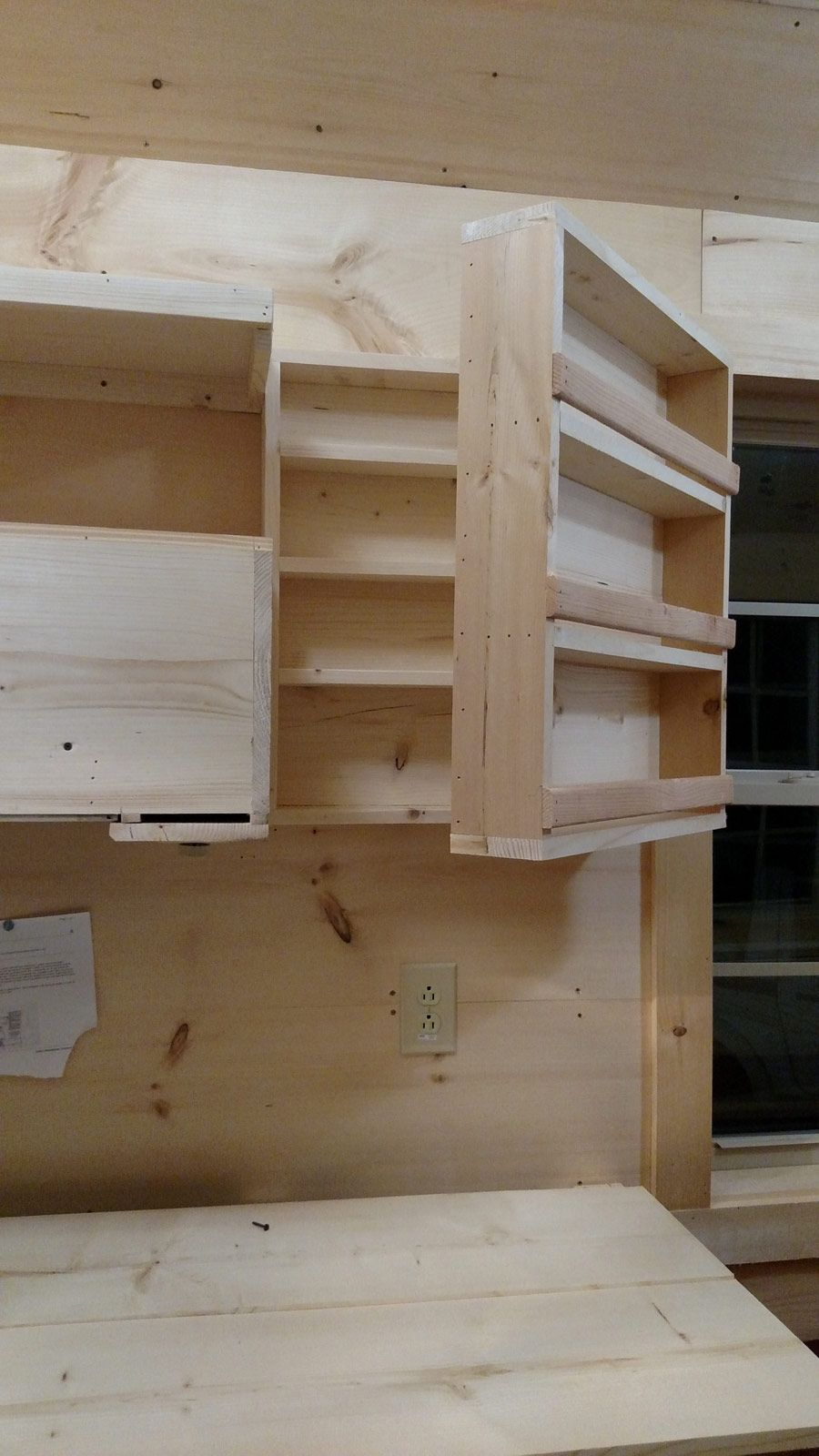 this is clever storage shelving that hinge opens to more storage shelving hidden behind when on kitchen cabinets vertical lines id=50478