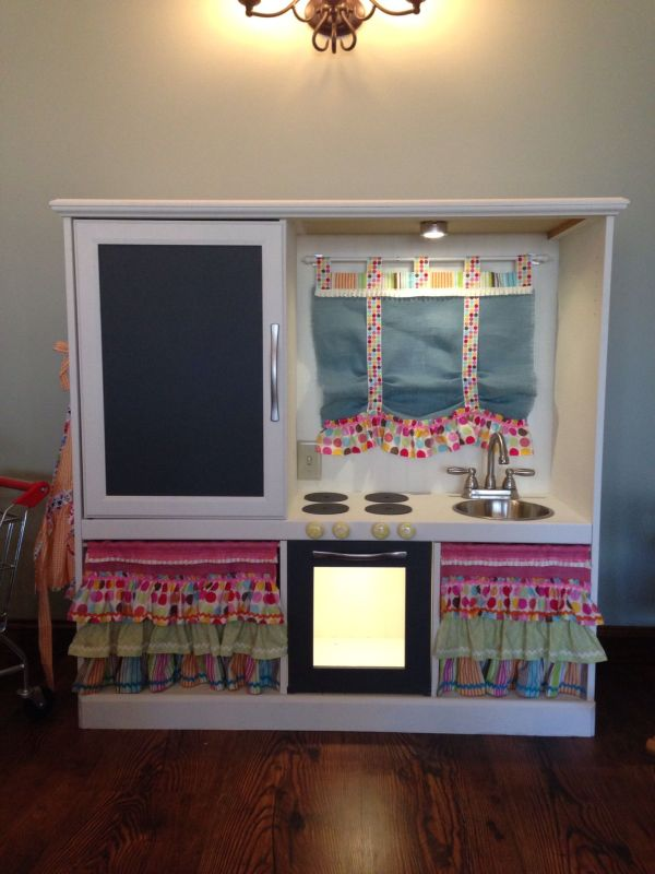 Turn an old entertainment center into a children's play ...
