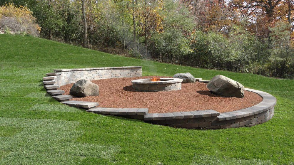 Natural fire pit area built into a slope.   Garden ... on Unlevel Backyard Ideas id=38468