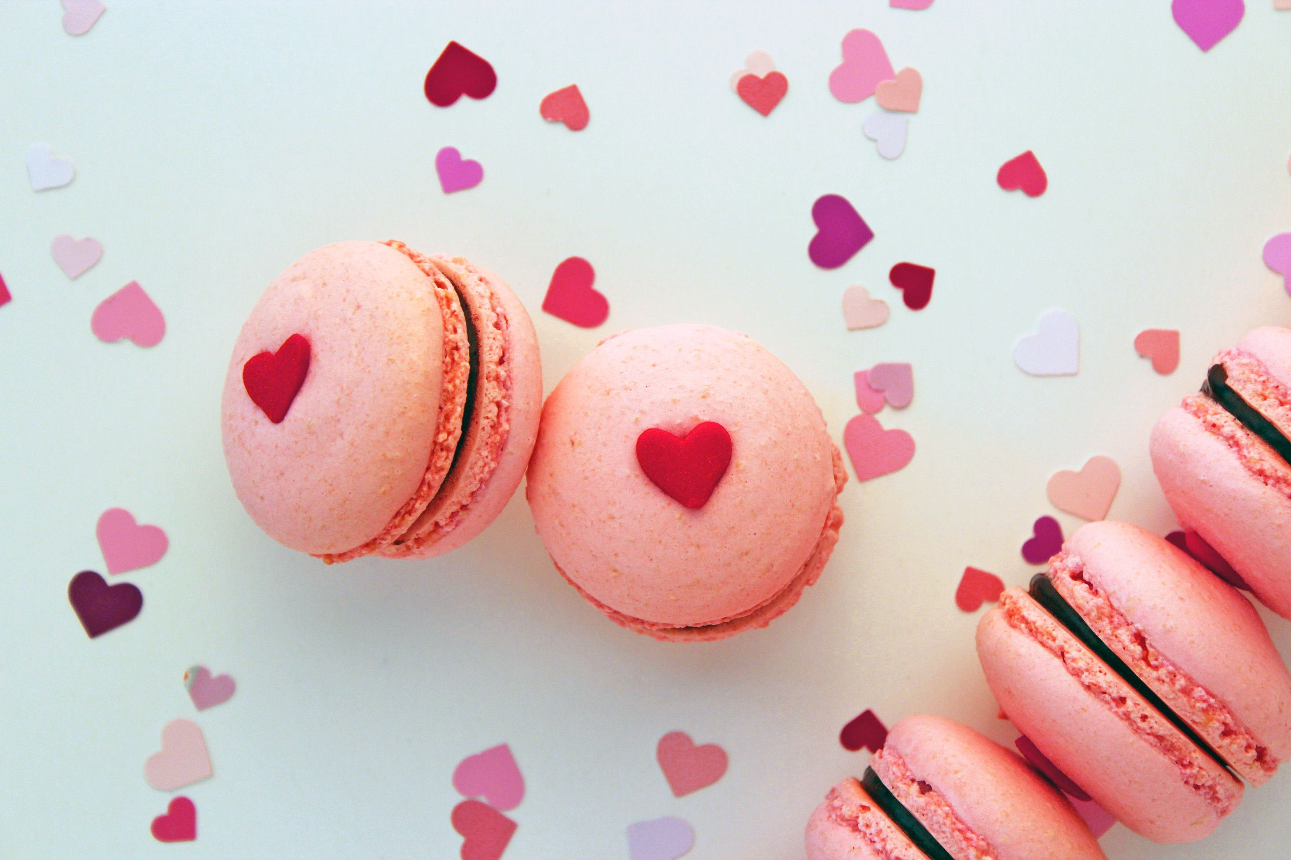 jumbo heart quins look adorable on these pink macarons | delicious