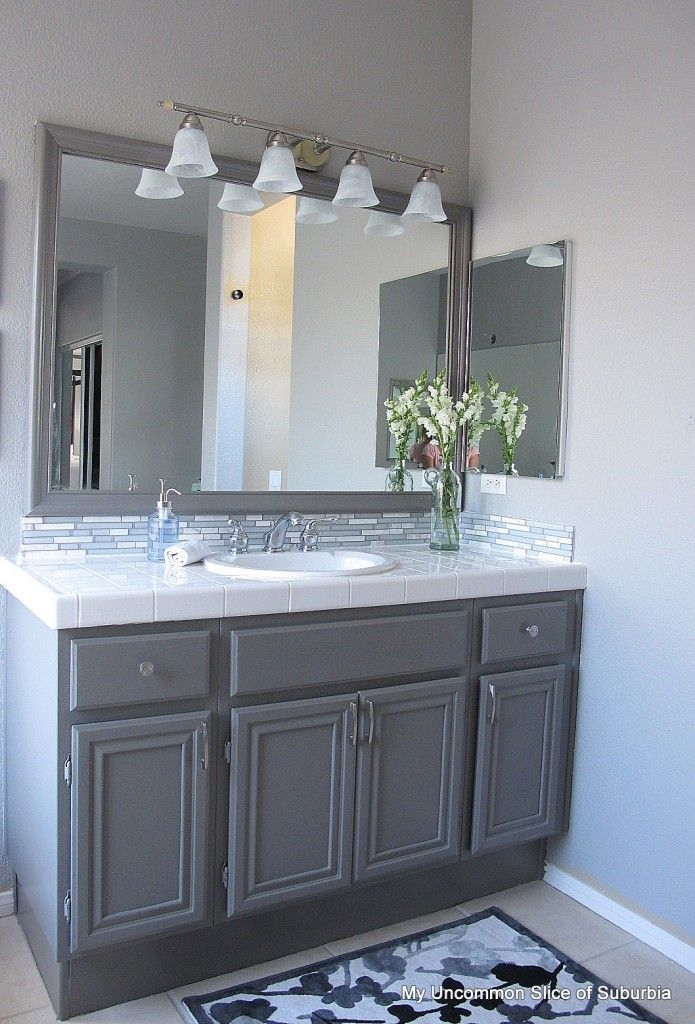 frame your mirror | painted oak cabinets, bathroom cabinets and