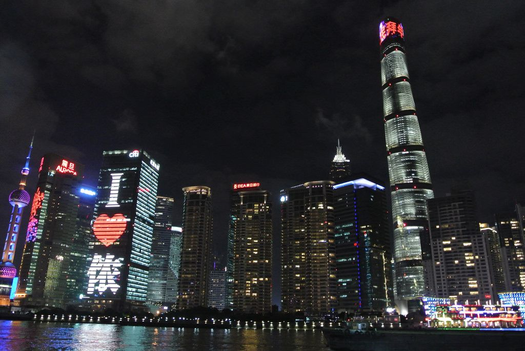 "The crown of Shanghai Tower showing the Chinese word ""拜年"" (giving Chinese new year's greetings) at night."