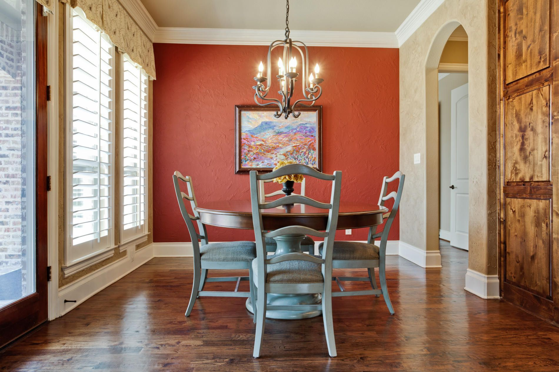 A Pop Of Red With Neutral Tan On Adjacent Walls