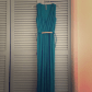 Green deep v jumpsuit with gold plated belt gold