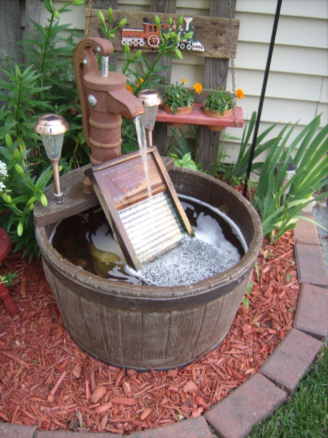 Barrel water fountain added old glass washboard with a