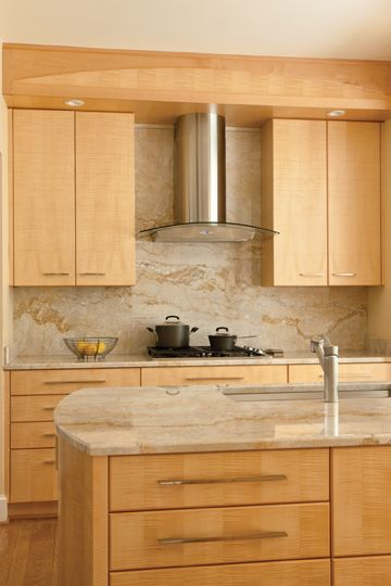 Vallon paired Tiger's Eye maple cabinets with marble-like ... on Light Maple Cabinets With Black Countertops  id=36311
