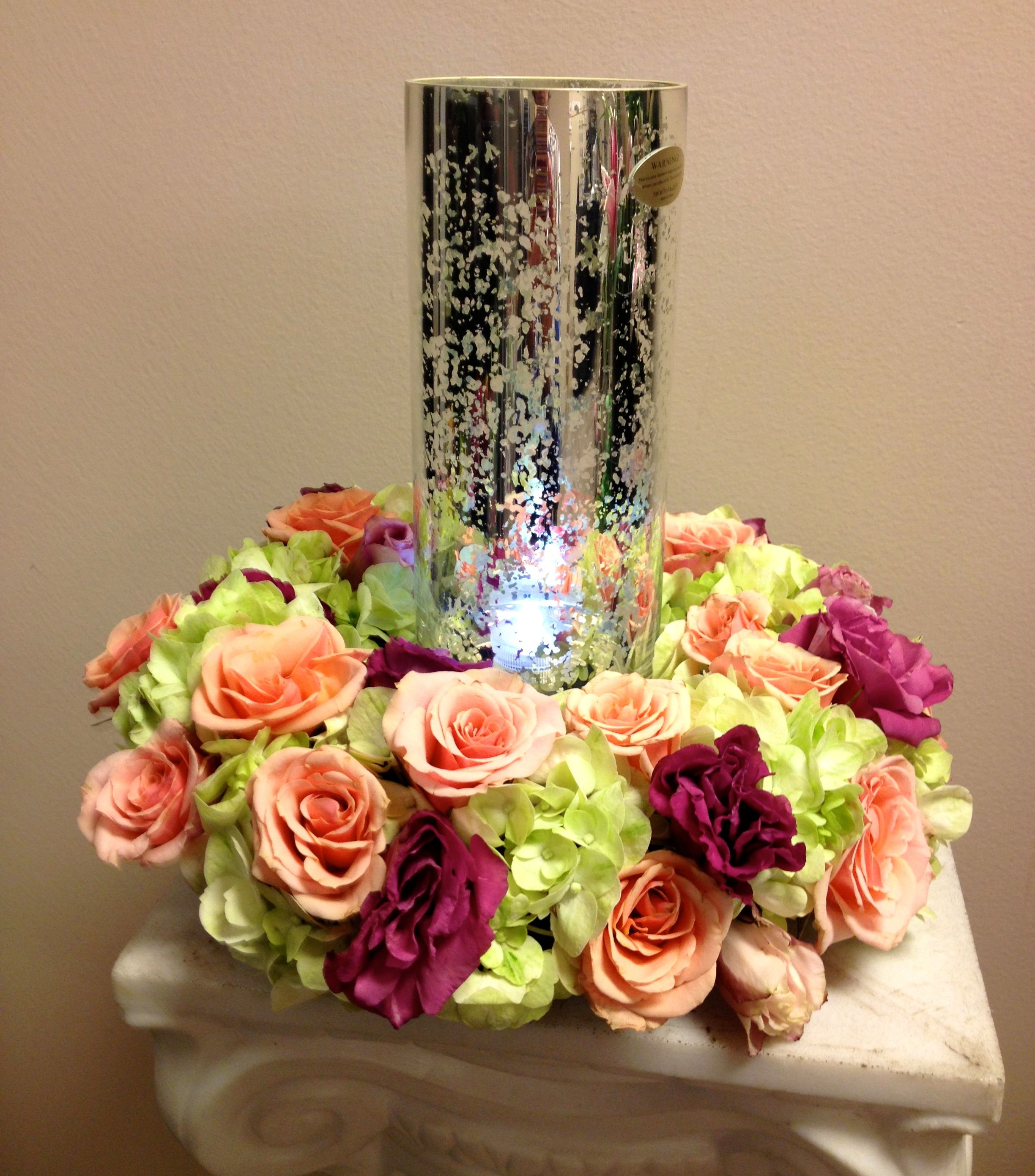 Lovely Wreath Of Flowers Around A Glass Hurricane Candle