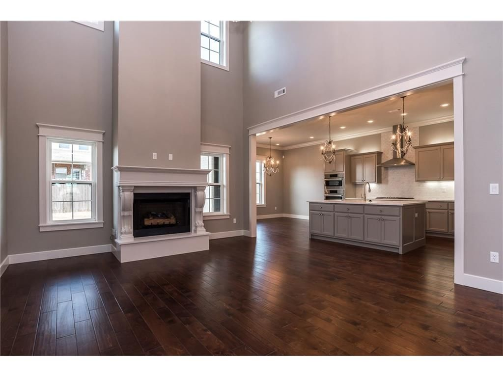 Transitional Living Room And Kitchen With Gray Cabinets
