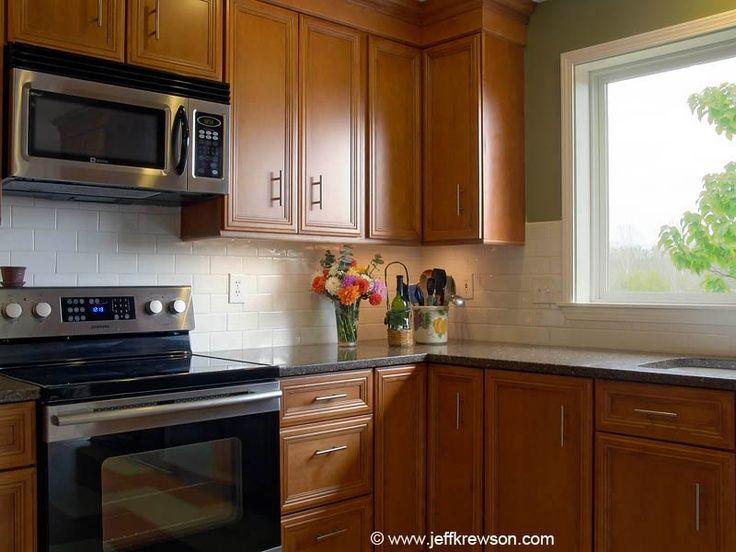black quartz countertops white subway tile backsplash ... on Natural Maple Cabinets With Black Granite Countertops  id=96945