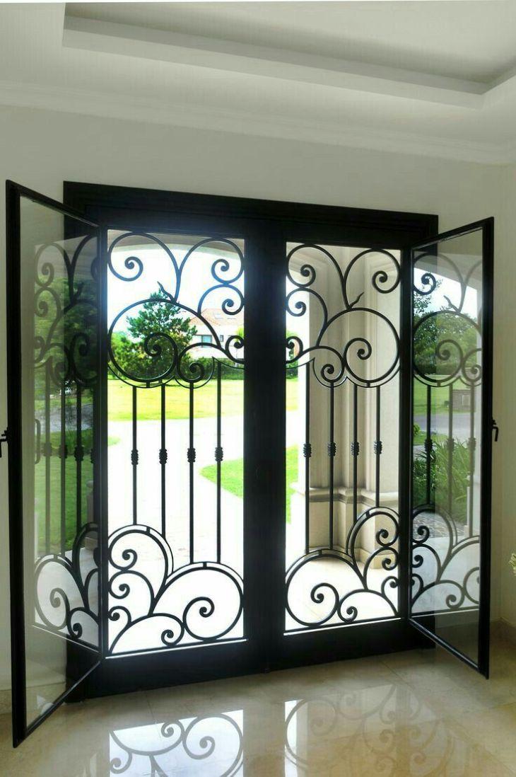 Iron and glass front double doors Window ideas Pinterest Iron