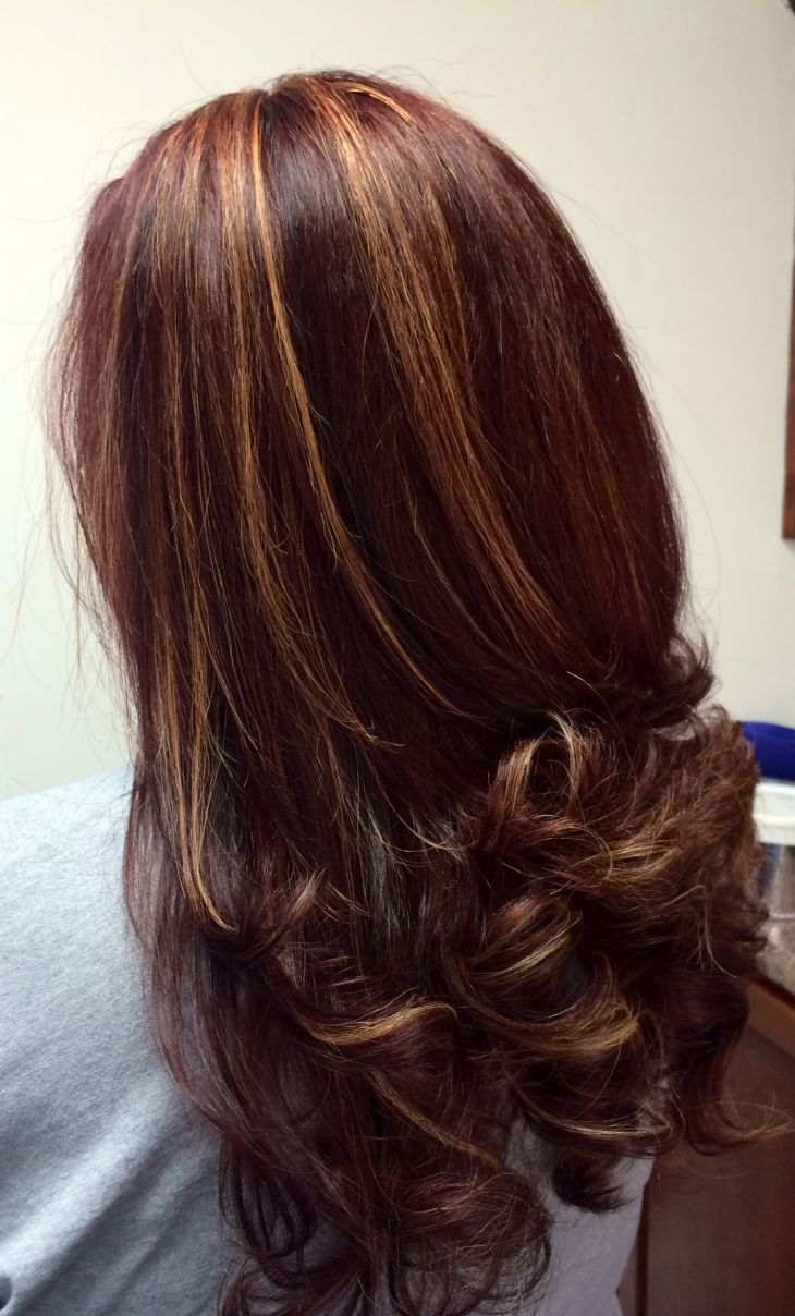 Multi dimensional hair color Red base with caramel highlights and