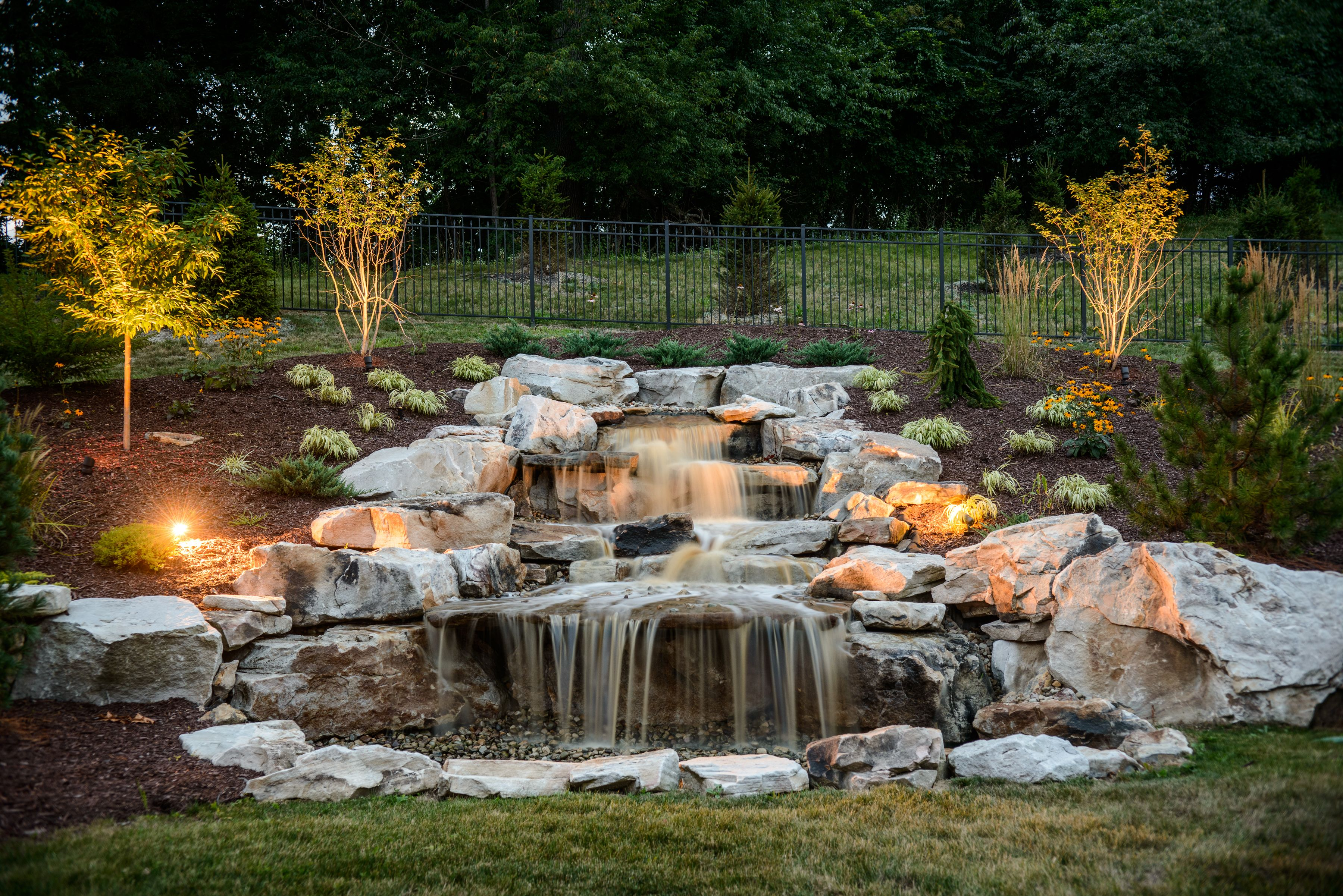 Add outdoor lighting to your pondless waterfall | Water ... on Front Yard Waterfall Ideas id=49921