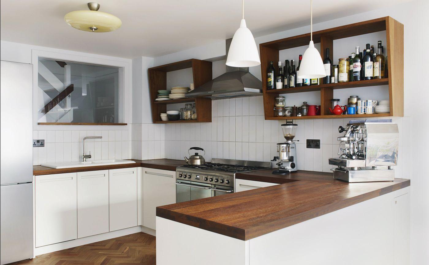 Modern Kitchen With White Cabinets And Dark Wooden Worktop